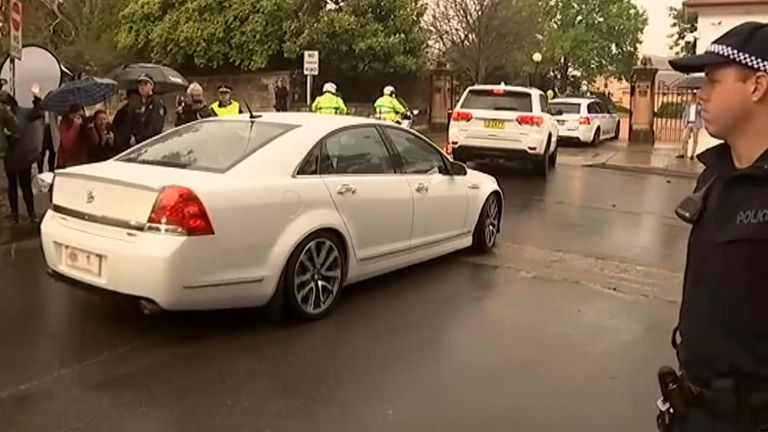 The couple's motorcade entering Governor General Peter Cosgrove's Sydney home