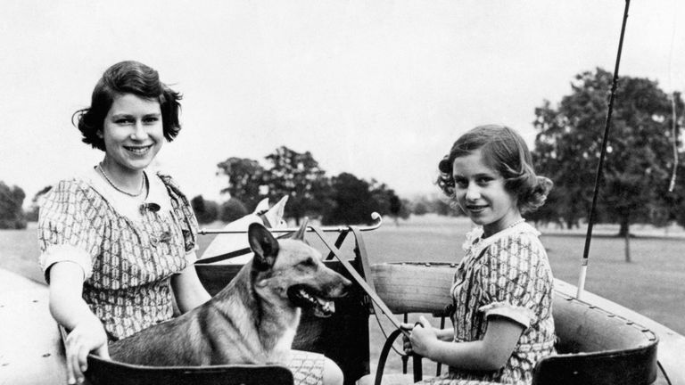 1941: Princess Elizabeth and Princess Margaret with one of their dogs