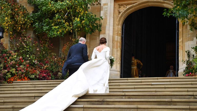 Princess Eugenie arrives with her father, the Duke of York, for her wedding
