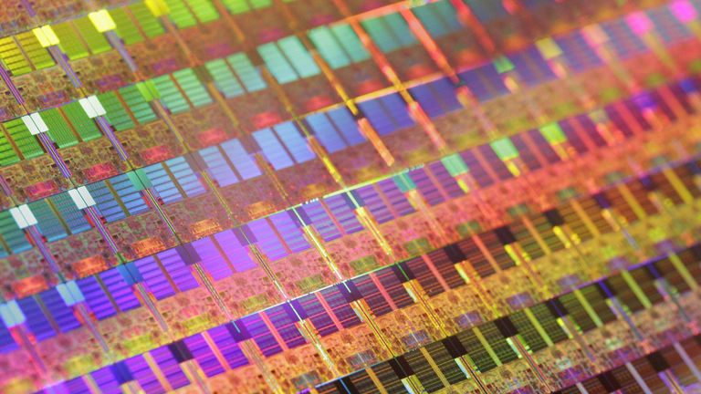 A 45nm process 300mm silicon wafer is displayed at a press conference as Intel Japan announces the launch of the new 45nm process microprocessors, Xeon processor for servers and Core2 Extreme processors for desktop PC, in Tokyo 13 November 2007. The new processors have improved power efficiency and performance compared with current 65nm processors. AFP PHOTO / Yoshikazu TSUNO (Photo credit should read YOSHIKAZU TSUNO/AFP/Getty Images)