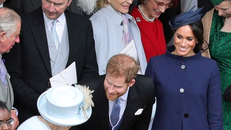 Queen Elizabeth talks with Prince Harry and Meghan, Duchess of Sussex