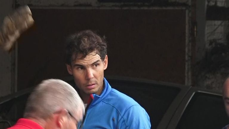 Tennis star Rafael Nadal helps with clean-up operation in Majorca following heavy flooding