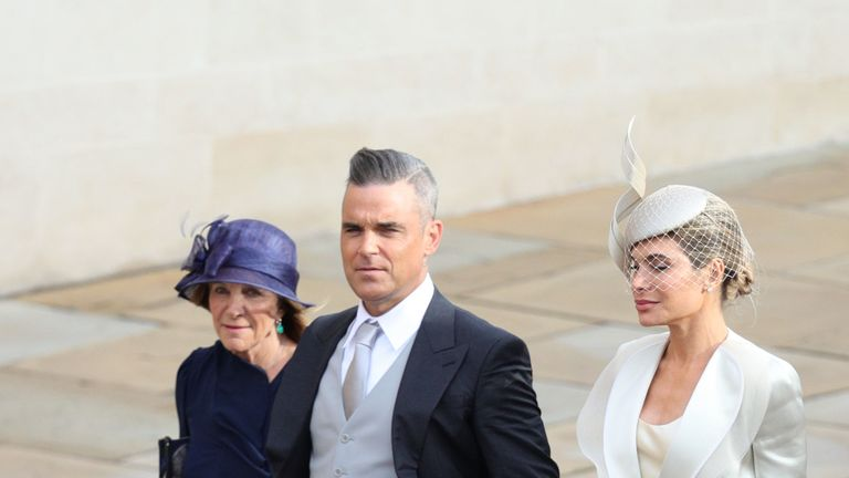 Robbie Williams and Ayda Field arrive