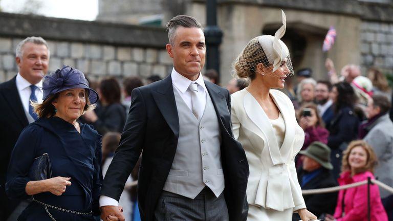Gwen Field, Robbie Williams and Ayda Field arrive