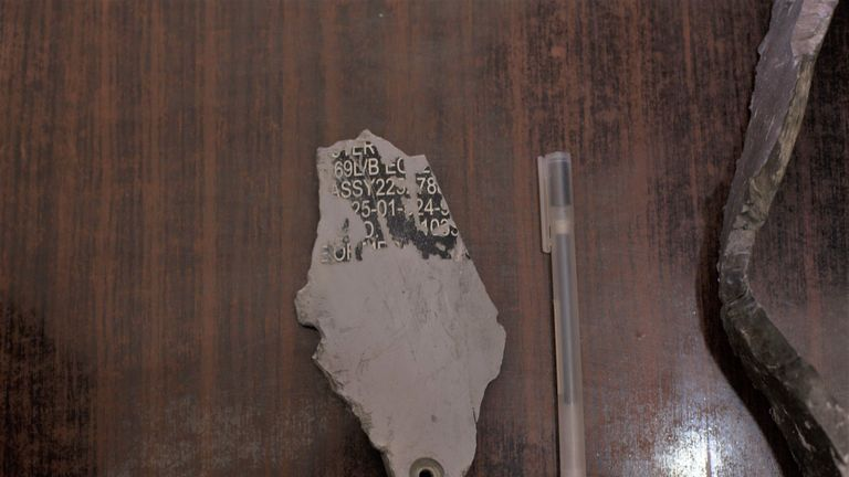A fragment of the bomb that hit Buthaina's house that Amnesty says is US-made
