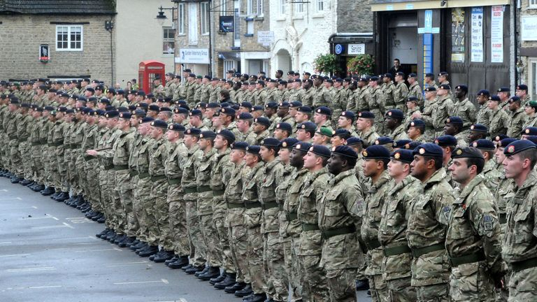 Soldiers from 9 Theatre Logistic Regiment, form up for an operational medals parade in Malmesbury, Wiltshire. to mark their return to the UK after a 6 month deployment to Iraq.
