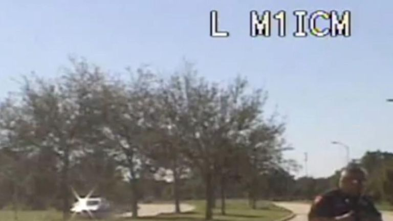 Texas police dashcam catches a spider on the windscreen that looks like a giant in the road