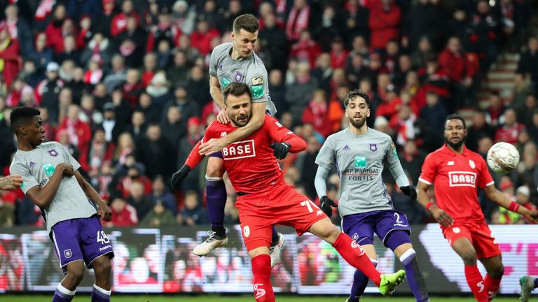 Standard Liege (red) and Anderlecht (grey) are among the top clubs to have been raided by police
