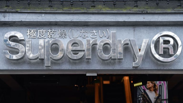 The logo of the British clothing retailer chain Superdry is on display on the facade of a store in Brussels, on February 8, 2018. (Photo by Emmanuel DUNAND / AFP) (Photo credit should read EMMANUEL DUNAND/AFP/Getty Images)
