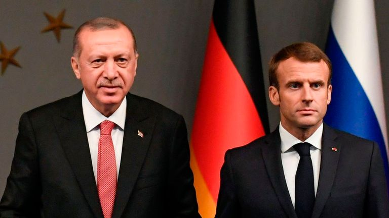 Recep Tayyip Erdogan and Emmanuel Macron stand together at the Syria conference in 2018