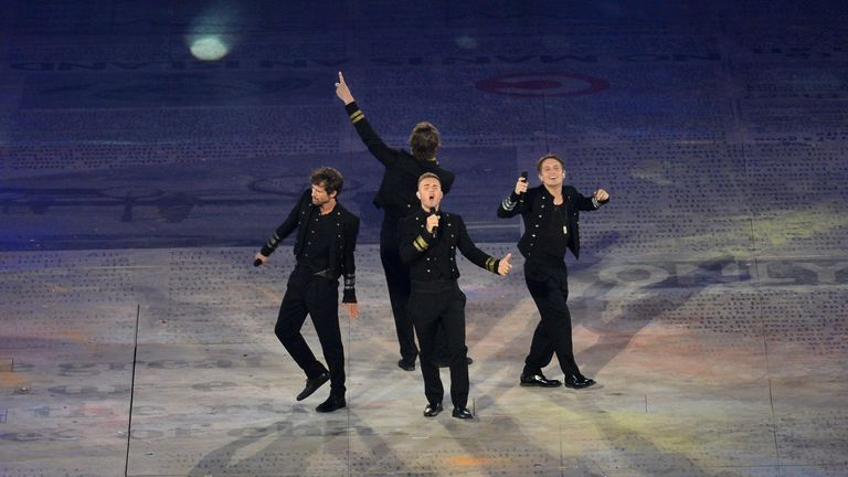 Take That (Gary Barlow, Mark Owen, Jason Orange and Howard Donald) perform during the Closing Ceremony of the London 2012 Olympic Games