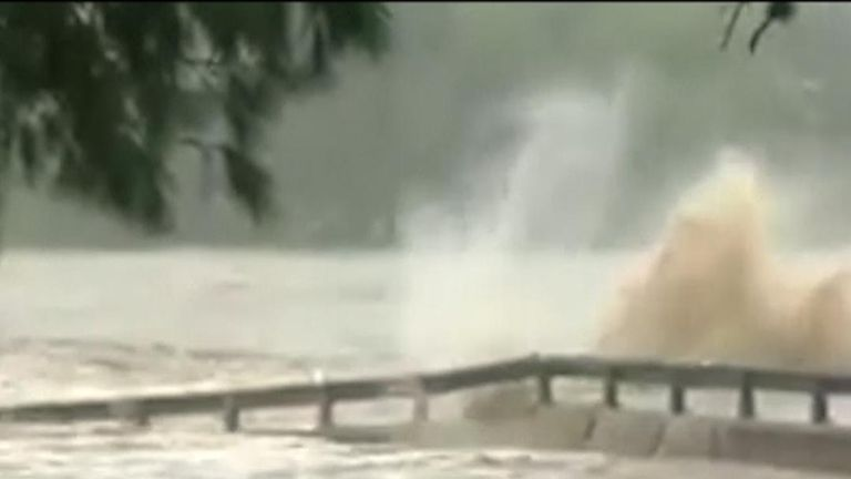 Flood waters swell the Llano River in Texas and destroy a bridge