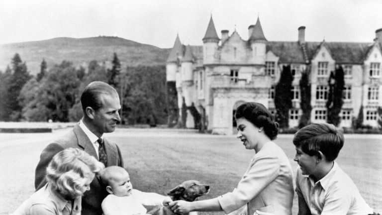 1960: Baby Prince Andrew and the rest of the family at Balmoral, with a dog alongside