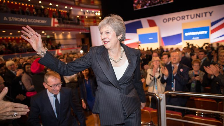 Theresa May waves to supporters after her speech to the Tory conference