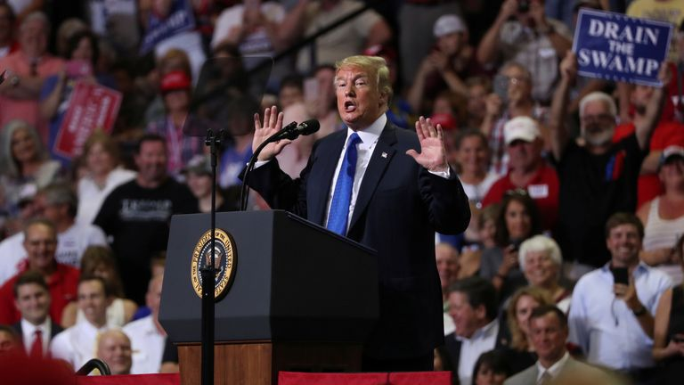 U.S. President Donald Trump addresses supporters during a Make America Great Again rally in Southaven, Mississippi, U.S. October 2, 2018.