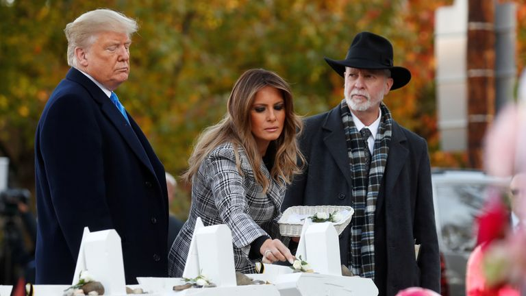 U.S. President Donald Trump and first lady Melania Trump stand with Rabbi Jeffrey Myers as they place stones at a makeshift memorial outside the Tree of Life synagogue in the wake of the shooting at the synagogue where 11 people were killed and six people were wounded in Pittsburgh, Pennsylvania, U.S., October 30, 2018