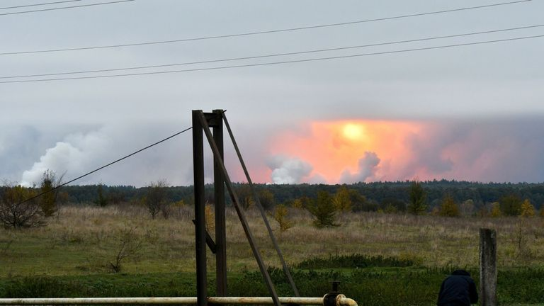 A fireball can be seen in the sky after explosions at the ammunition depot in north Ukraine
