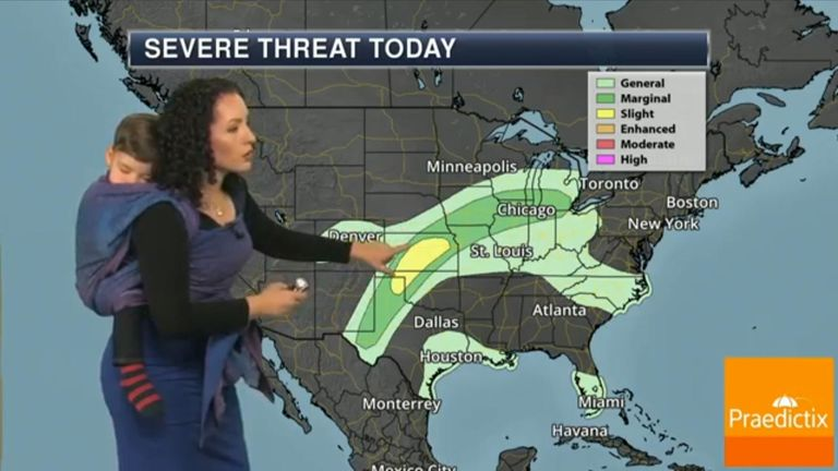 Meteorologist Susie Martin participated in International Baby-Wearing Week  and 'wore' her sleeping baby during a forecast