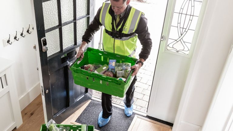 Delivery staff will unpack customers' groceries under the new scheme