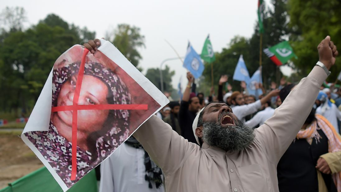A supporter of the Ahle Sunnat Wal Jamaat (ASWJ), a hardline religious party, holds an image of Asia Bibi during a protest rally