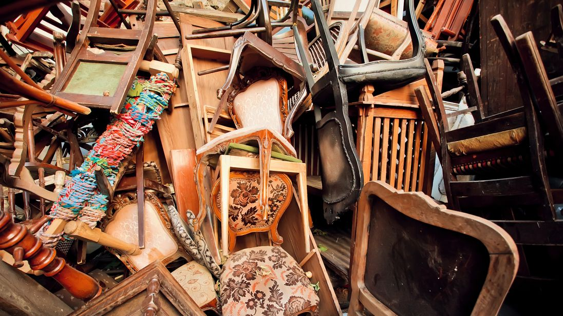 Dump old wooden chairs and vintage chairs, one on the other, thrown into the street