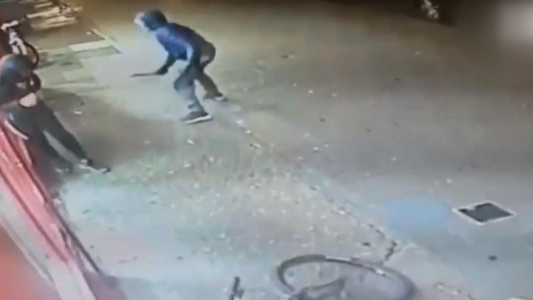 The CCTV shows an attacker approaching Jay with a knife