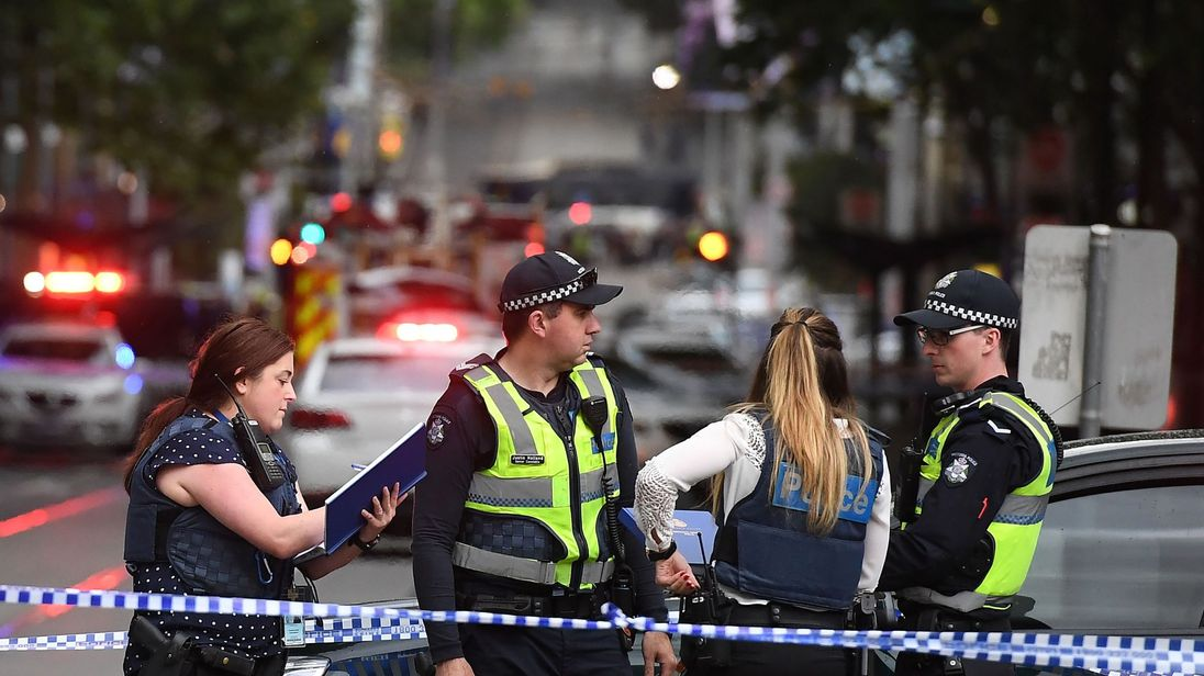 Police work at the crime scene following a stabbing incident in Melbourne on November 9, 2018
