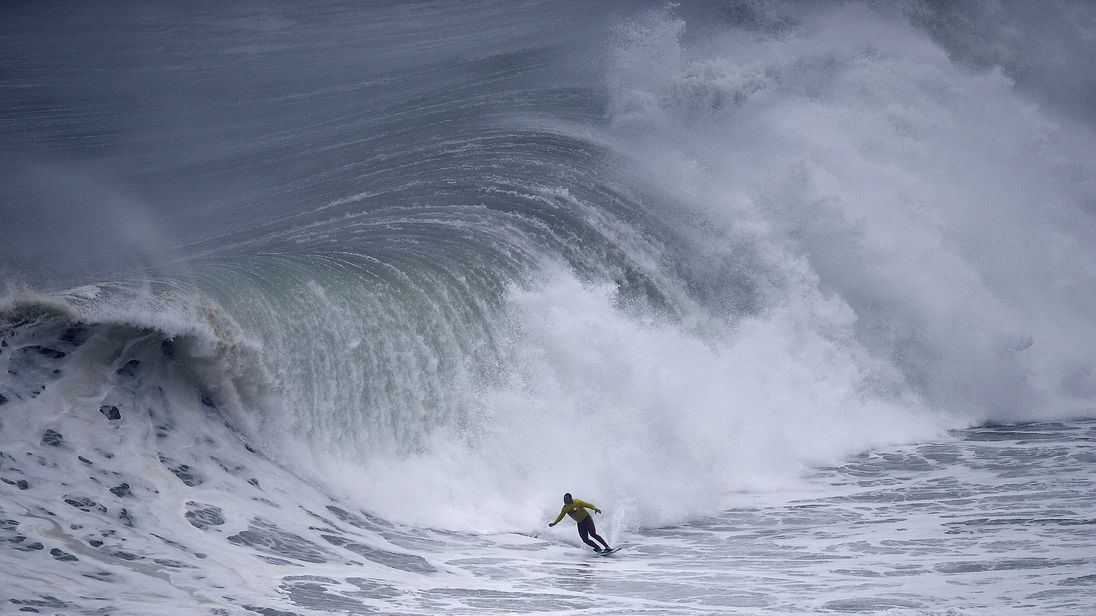 McNamara rides a wave during a surf session at Praia do Norte in Nazare