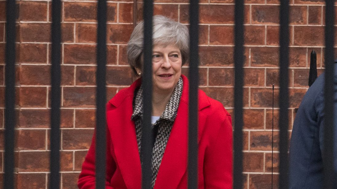 May sticks to Brexit deal, challenge looms