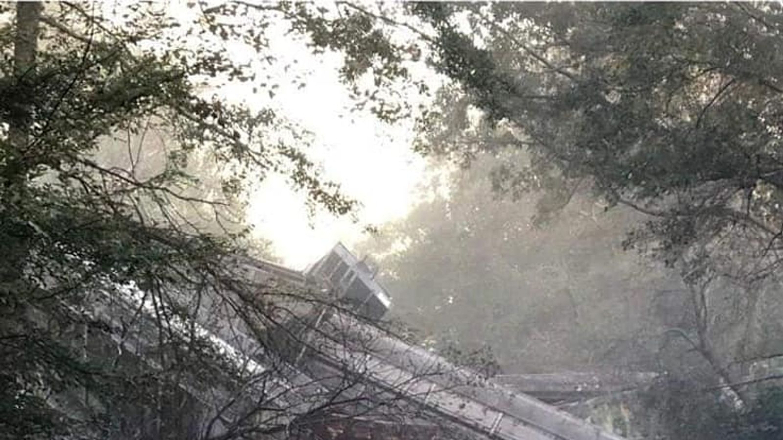 Dozens of carriages fall on highway after train derails