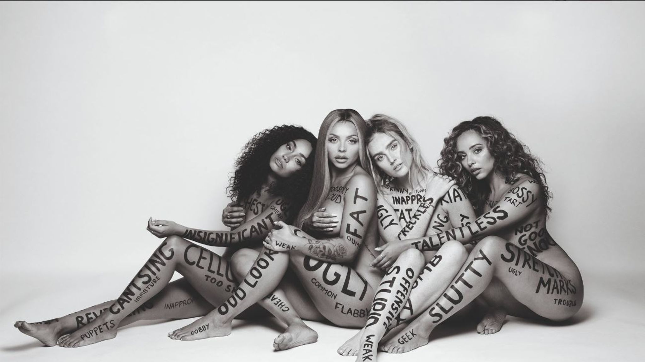 Little Mix pose naked and scrawled with insults for new song