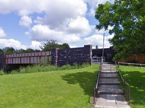 The 14-year-old girl was walking towards this alleyway in Bolton when she was chased. Pic: Google Streetview