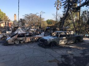 Destroyed cars in a suburb in Malibu. Sky News pic