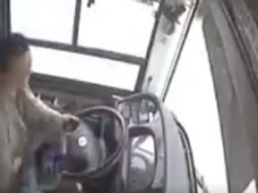 The driver of the bus is hit by a passenger. Pic: China Daily
