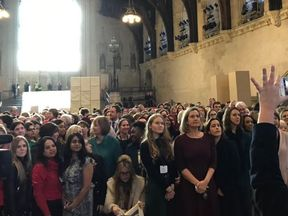 Women MPs pose with people attending the event