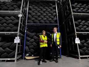 First Minister of Scotland Nicola Sturgeon (L) is shown around by manager John Reid (R) during a visit to the Michelin Tyre factory in Dundee, Scotland on June 21, 2017