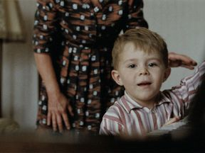The young Elton sees his piano for the first time at the end of the advert