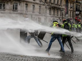 There were tense scenes in Paris as protesters tried to reach the Elysees Palace
