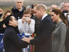 The duke held Aiyawatt's hand before introducing him to the duchess