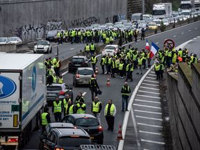 Demonstrators block the traffic on the highway A47 between Lyon and Saint-Etienne on November 17, 2018