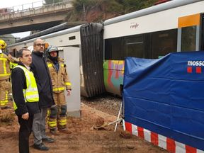 Interior minister Miquel Buch inspects the scene of a derailed train. Pic: Catalonia Interior Ministry