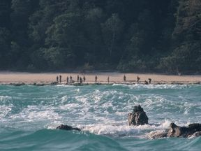 The Sentinelese stand guard on an island beach. Pic: © Christian Caron – Creative Commons A-NC-SA