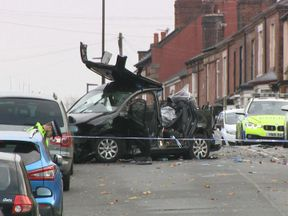 Officers attend the scene of the crash