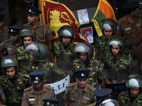 Soldiers keep watch outside the Ceylon Petroleum Corporation in Colombo after violence erupted