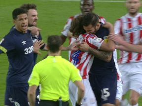 The moment many thought Johnson (R) bit Joe Allen. Pic: Sky Sports