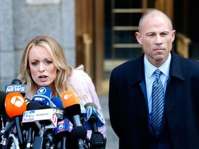 Adult film actress Stephanie Clifford, also known as Stormy Daniels, speaks to media along with lawyer...