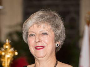Prime Minister Theresa May arrives at the Lord Mayor's Banquet at the Guildhall in London.