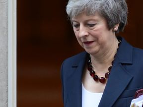 LONDON, ENGLAND - NOVEMBER 14: Prime Minister Theresa May leaves 10 Downing Street for Prime Minister's questions on November 14, 2018 in London, England. Theresa May will today attempt to secure the backing of her government ministers for the Brexit deal at a special cabinet meeting in Downing Street this afternoon. Brexiteers are already decrying the deal as a betrayal and urging ministers to reject the deal. (Photo by Dan Kitwood/Getty Images)