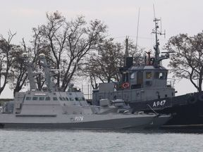 Seized Ukrainian ships, small armoured artillery ship and a tug boat, anchored in a port of Kerch, Ukraine