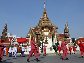 Monks attend a procession with royal soldiers at the temple where the funeral of Vichai Srivaddhanaprabha